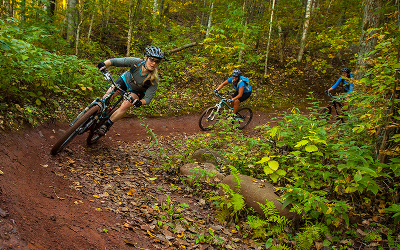 "Dirty bikes caked in the iron-rich red dirt of Cuyuna is a kind of ""badge of honor"" among cyclists who've been there. <i> Photo by Aaron W. Hautala </i>"
