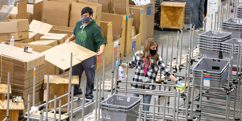 warehouse employees working with face masks on