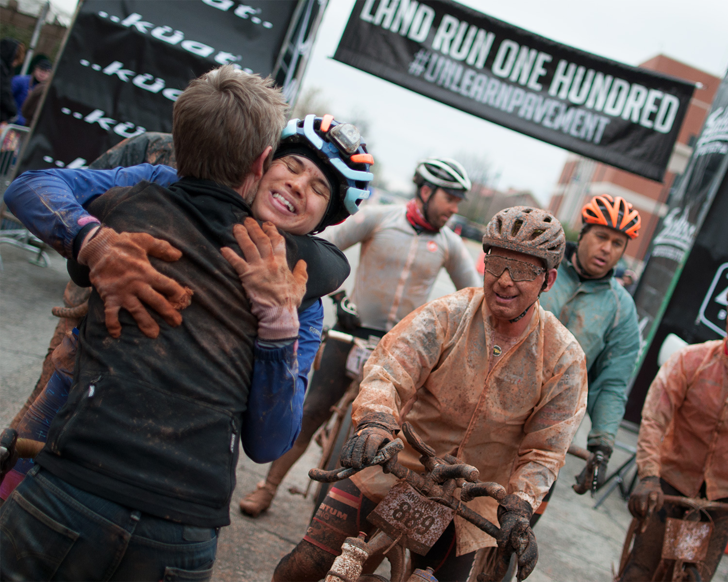 Andrea Cohen receives a warm embrace at the 2017 Land Run 100 finish line. Photo courtesy of Salsa Cycles